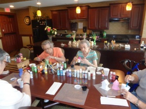 the villas of lilydale senior living, senior living activities, birdhouse painting crafts