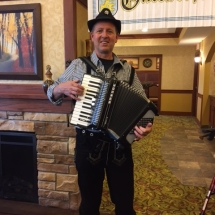Oktoberfest Celebration-Villas of Lilydale-cheesin accordion player