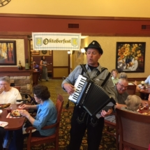 Oktoberfest Celebration-Villas of Lilydale-the tenants, family, and friends enjoying the buffet and accordion music