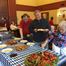 Oktoberfest Celebration-Villas of Lilydale-digging into the buffet